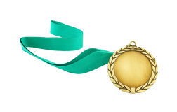 Gold medal with green ribbon Royalty Free Stock Images