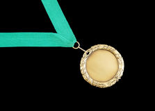 Gold medal with green ribbon Stock Photo