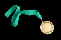 Gold medal with green ribbon Stock Images
