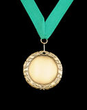Gold medal with green ribbon Royalty Free Stock Image
