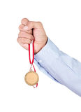 Gold medal in hand Royalty Free Stock Photo