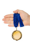 Gold medal in hand. Isolated on white background Stock Images