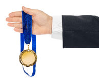 Gold medal in hand. Isolated on white background Stock Photo