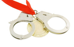 Gold medal with handcuffs Stock Image