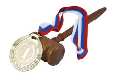 Gold medal and judge's gavel Stock Photos