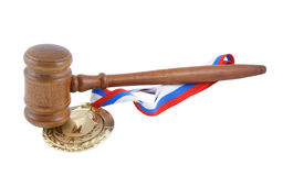 Gold medal and judge's gavel Stock Images