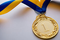 Gold medal on a light background Stock Images