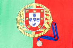 Gold medal on portuguese flag Royalty Free Stock Photography
