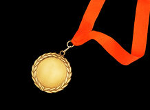 Gold medal with red ribbon Stock Photos