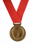 Gold medal on red ribbon Stock Photography