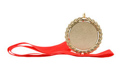 Gold medal with red ribbon isolated Stock Photo