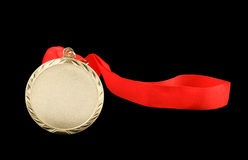 Gold medal with red ribbon isolated Stock Photography