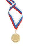 Gold medal with red ribbon isolated Royalty Free Stock Image