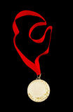Gold medal with red ribbon isolated Stock Image