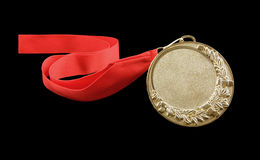 Gold medal with red ribbon isolated Royalty Free Stock Photos