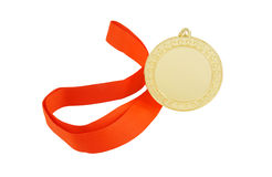 Gold medal with red ribbon isolated Stock Photos