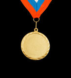 Gold medal with ribbon Stock Photography