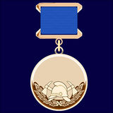 Gold medal. With ribbon on a blue background Royalty Free Stock Photography