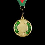 Gold medal with ribbon isolated Royalty Free Stock Photos