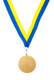 Gold Medal on a ribbon. Gold Medal isolated on white background Royalty Free Stock Photo