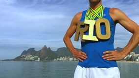 Gold Medal RIO Athlete Standing Ipanema Beach. RIO first place athlete wearing gold medals standing outdoors on Ipanema Beach Rio de Janeiro Brazil stock video