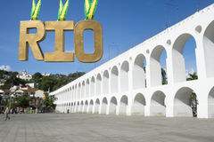Gold Medal RIO Message at Lapa Arches. Gold medal RIO hanging in the plaza in front of the famous Arcos da Lapa Arches landmark in Rio de Janeiro Brazil Royalty Free Stock Images
