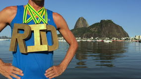 Gold Medal RIO Olympic Athlete Standing Ipanema Beach. RIO 2016 first place athlete wearing gold medals standing outdoors at Botafogo Bay Rio de Janeiro Brazil stock video