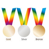 Gold medal, silver medal, bronze medal on multicolor ribbons with shiny metallic surfaces. Royalty Free Stock Images