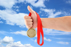 Gold medal on sky background Royalty Free Stock Photos