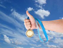Gold medal on sky background Royalty Free Stock Images