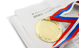 Gold medal on sport newspaper isolated Stock Images