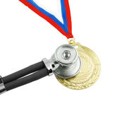Gold medal and stethoscope isolated Royalty Free Stock Photography