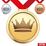 Gold Medal with the symbol of a crown inside Stock Images