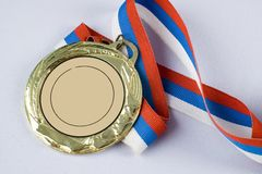 Gold medal with tricolor ribbon Royalty Free Stock Photo