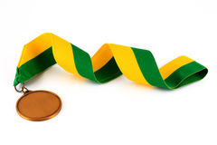 Gold medal on white background with blank face for text, Gold medal in the foreground. Royalty Free Stock Photography