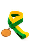Gold medal on white background with blank face for text, Gold medal in the foreground. Stock Photo
