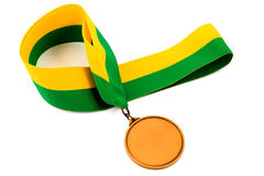Gold medal on white background with blank face for text, Gold medal in the foreground. Royalty Free Stock Image