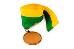 Gold medal on white background with blank face for text, Gold medal in the foreground. Stock Photos