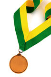 Gold medal on white background with blank face for text, Gold medal in the foreground. Stock Images