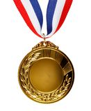 Gold medal on white. Closeup of golden medal on plain background Stock Photos
