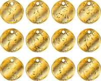 Gold medallions of the zodiac. Royalty Free Stock Photos