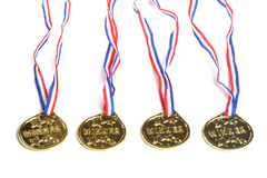 Gold Medals. Photograph of plastic gold medals with winner on the face Stock Photo