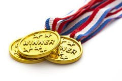 Gold medals. Three gold medals and ribbons on white background stock image