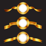 Gold medals. Golden metal badges with ribbons. Stock Photo