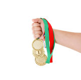 Gold medals in hand isolated Royalty Free Stock Images