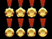 Gold medals vector collection on red ribbons Royalty Free Stock Images