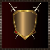 Gold medieval shield for the design. Royalty Free Stock Photo