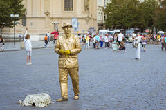 Gold meme posing on old Town Square Royalty Free Stock Image