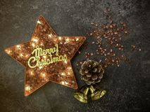 Gold Merry Christmas sign with red crystal bits with star shape and Led-ribbon light growing inside, X-mas festive decoration. Gold Merry Christmas sign with stock photos