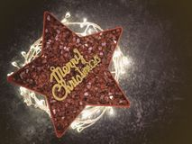 Gold Merry Christmas sign with red crystal bits with star shape and Led-ribbon light underneath,X-mas festive decoration. Background stock photos